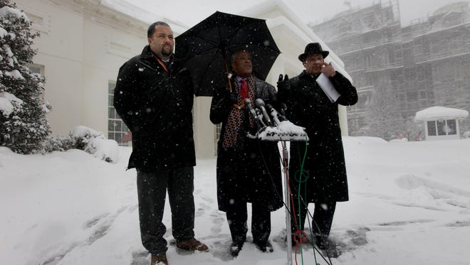 From left, NAACP president Benjamin Todd Jealous, Rev. Al Sharpton of the National Action Network and National Urban League president Marc Morial speak to members of the media outside the West Wing of the White House following their meeting with President Obama in Washington in February 2010.