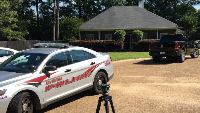 Byram police respond to the scene of a homicide Tuesday.