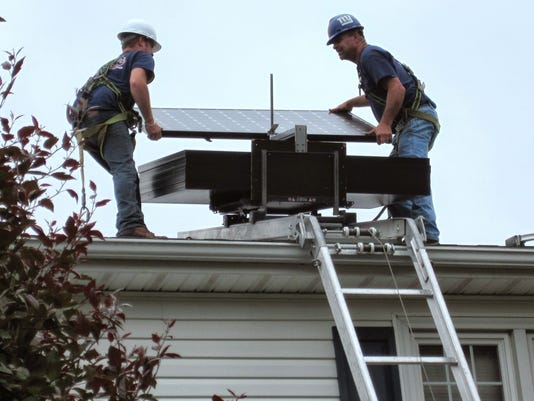 636232837371657259-ETM-Crew-installing.JPG