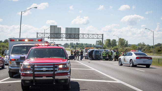 Crews attempt to clear a rollover wreck on I-69 near just south of the 245 exit in the northbound lanes. The third wreck featured above was the third accident in a short stretch of the highway.