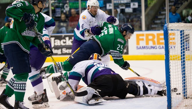 The Everblades' John McCarron (25) makes a diving attempt to score as Solar Bears' goalie Ryan Massa comes up with the save during the first period of Game 2 of the Kelly Cup Playoffs, South Division semifinals at Germain Arena Friday, April 14, 2017 in Estero, Fla.