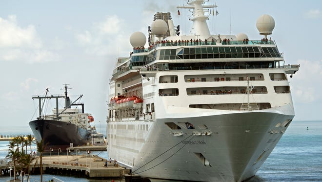In this photo provided by the Florida Keys News Bureau, the Empress of the Seas, right, docks at Pier B Sunday, Sept. 24, 2017, in Key West, Fla. The ship's port call marked the first time a cruise ship has docked in Key West since prior to Hurricane Irma's passage through the Florida Keys. At left is the Empire State, a ship used to house recovery workers.