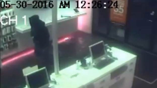 Security camera footage of the suspect who robbed several cell phones stores throughout the city.