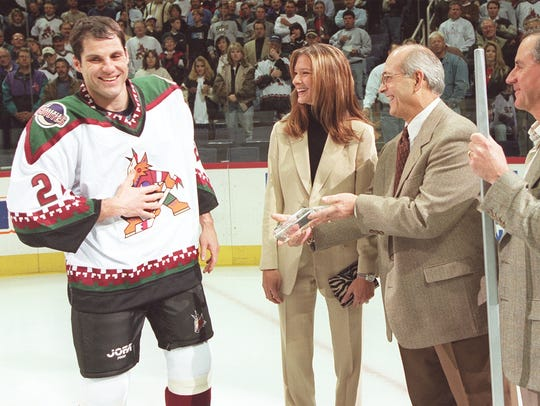 Rick Tocchet is honored in a pregame ceremony for scoring