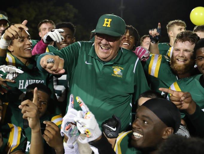 Farmington Hills Harrison coach John Herrington celebrates