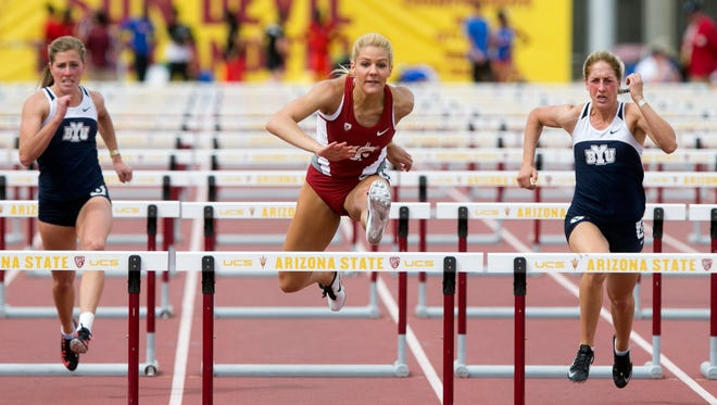Washington State's Andrea Smith (center) leads BYU's Angela Shields (left) and Erin Murphy (right) during the women's 100 meter hurdles during the Sun Angel Classic track & field meet at Sun Angel Stadium in Tempe on April 11, 2015.