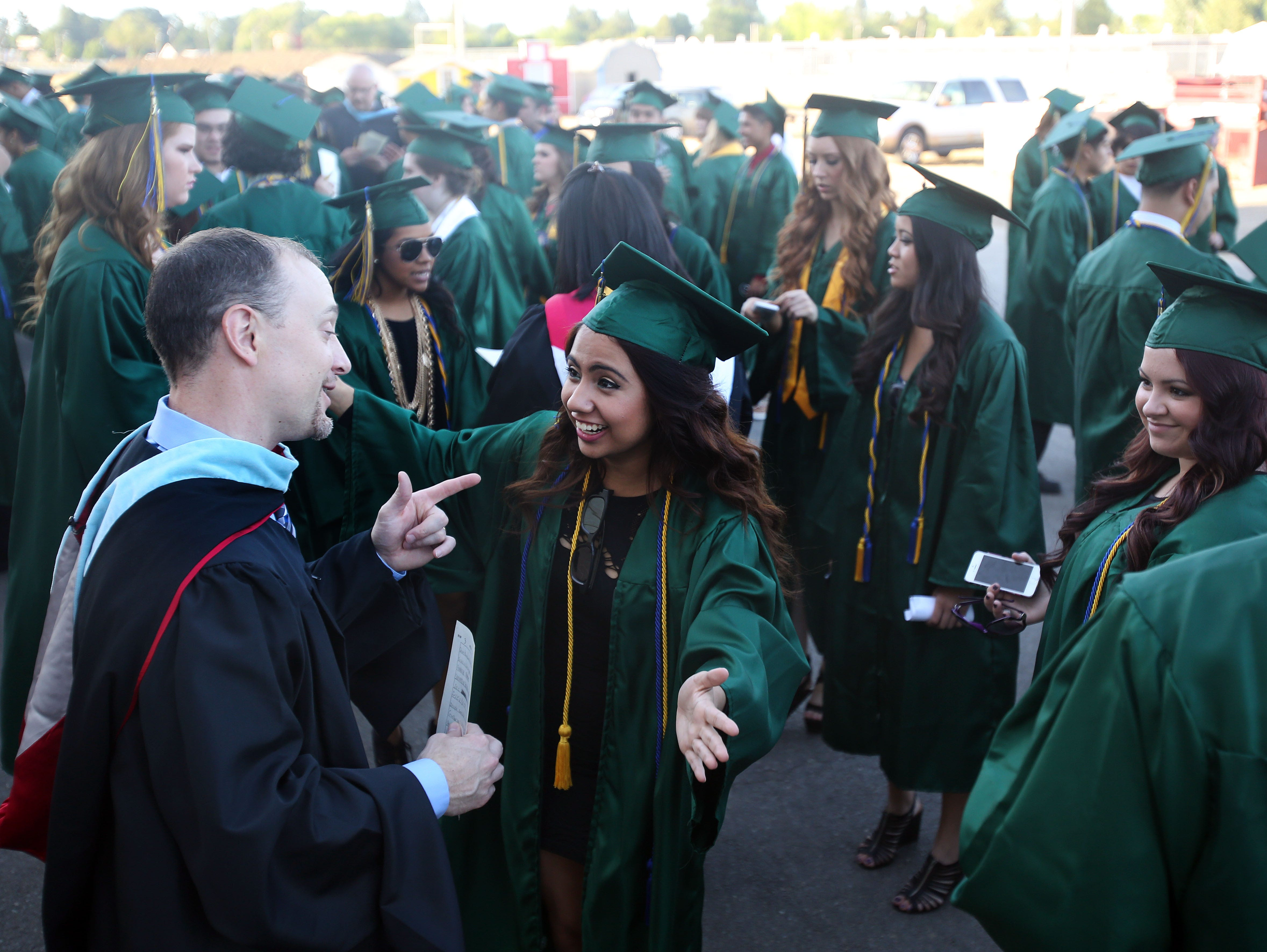 Trever Ball laughs with students at McKay's graduation in 2014.