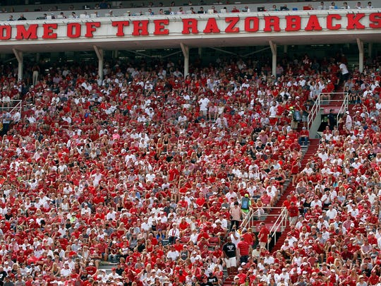 In this file photo, Arkansas fans cheer on the Hogs during a game against UTEP at Donald W. Reynolds Razorback Stadium in Fayetteville. The University announced Thursday that alcohol sales will be open to the general public this season.