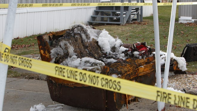 This burned couch was outside of Howard Kenny's mobile home Wednesday afternoon. Kenny was critically injured in a fire about 6:15 a.m. Wednesday.