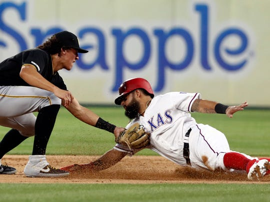 Pittsburgh Pirates shortstop Cole Tucker (3) tags out Texas Rangers' Rougned Odor (12) at second on a stolen base attempt in the first inning of a baseball game in Arlington, Texas, Tuesday, April 30, 2019. (AP Photo/Tony Gutierrez)