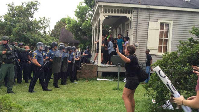 Cherri Foytlin of Rayne shot this photo Sunday, July 10, 2016, as law enforcement began to arrest protesters in Baton Rouge, La.