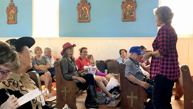Speaking in a church now used for community meetings in the Lincoln Historical Site, author Lynda Sanchez entertained her audience with stories from bootleg whiskey to Apaches and Billy the Kid, with some Nazi artifacts from Fort Stanton on display.