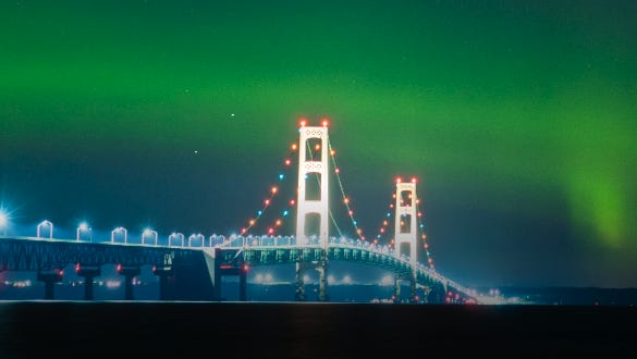 The Mackinac Bridge underneath the northern lights early July 17, 2017, in Michigan.