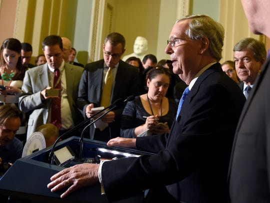 Sen. Mitch McConnell, R-Ky., speaks to reporters on