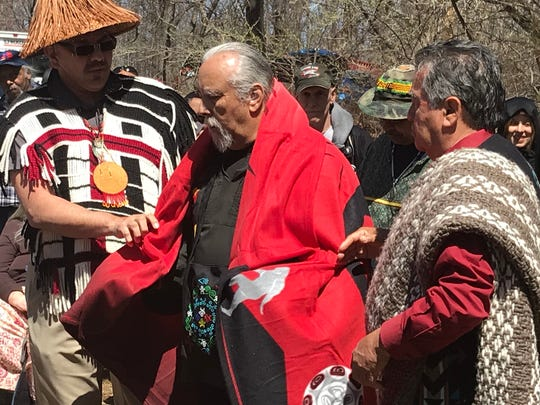 Ramapough Lenape Nation Chief Dwaine Perry is given a gift of a blanket by members of the Lummi Indian Nation on Saturday, April 21, 2018. The tribe, based in the northwest, brought a traveling totem pole to Mahwah as a way to unite American Indian tribes across the country who are fighting fossil fuel projects.