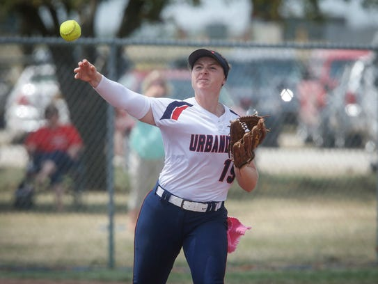 Urbandale senior Bella Crow fires a throw to first