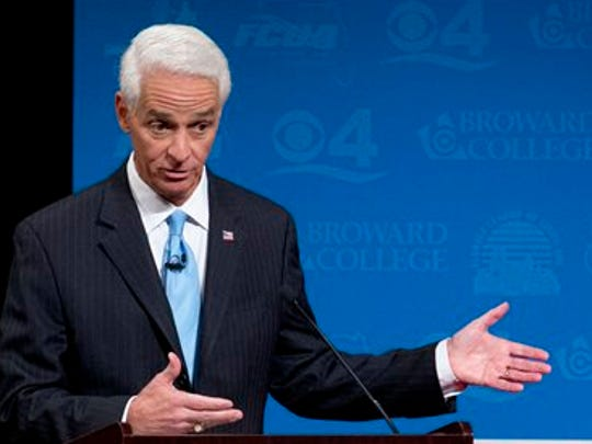 Democratic challenger, former Republican Gov. Charlie Crist gestures as he answers a question during debate against Florida Republican Gov. Rick Scott, Wednesday, Oct. 15.