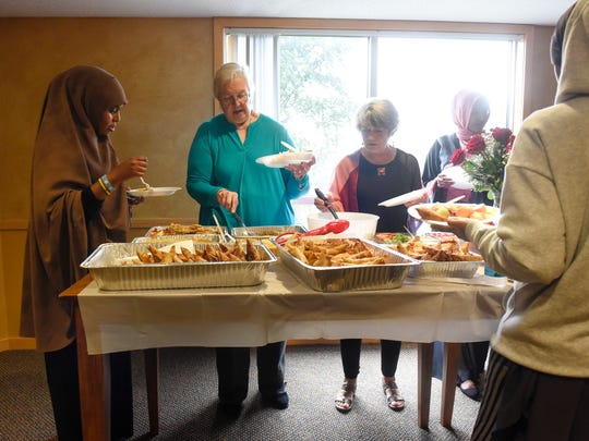 People choose from a wide variety of food during a Dine and Dialogue event Saturday, Aug. 26, in St. Cloud.