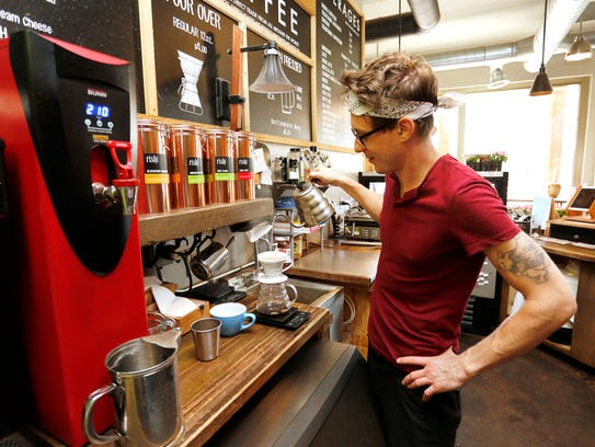Dillon Mills prepares a pour over coffee Monday, May