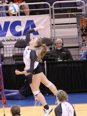 Novi senior Alyssa Cummings unloads for one of her 10 kills in the Class A finals.