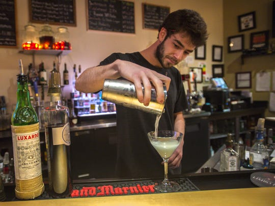 Bartender Dan Allen concocts an Aviation - with gin, maraschino liquor, lime, and creme de violette - at Drink in Burlington.