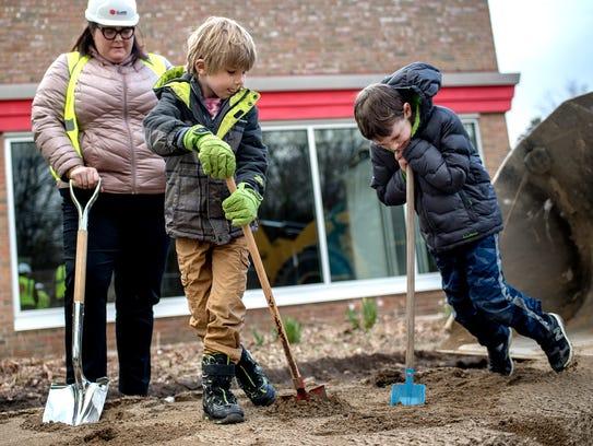 Finley Kaufmann, 6, center, and Gabriel Vincent, 7,