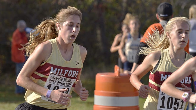 Mallory Barrett (left) led Milford to the state Division 1 cross country championship last fall.
