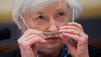 Federal Reserve Chair Janet Yellen adjusts her glasses as she testifies on Capitol Hill on June 22, 2016.