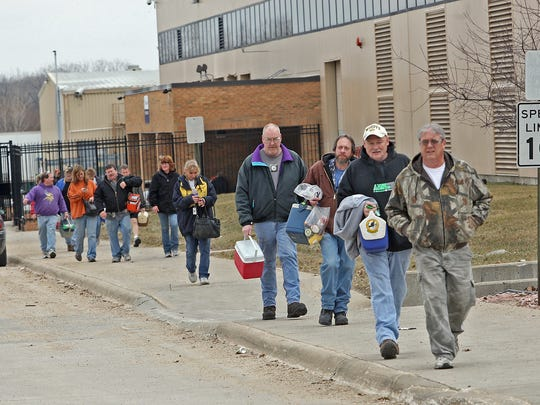 Employees leave after a 3 p.m. shift change days before the Electrolux plant in Webster City closed in 2011. The washer and dryer factory's work was moved to Mexico.