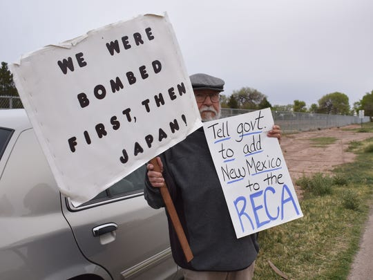 Ernesto Borunda joins the Tularosa Basin Downwinders in their peaceful demonstration on Saturday morning.