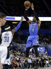 Oklahoma City Thunder's Russell Westbrook (0) shoots over Orlando Magic's Terrence Ross (31) during the first half of an NBA basketball game, Wednesday, March 29, 2017, in Orlando, Fla.