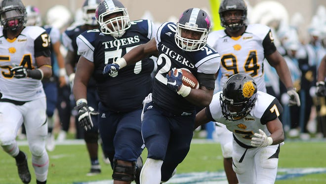 JSU running back Robert Johnson IV, pictured with the ball, has rushed for 100 yards in each of the past two games.