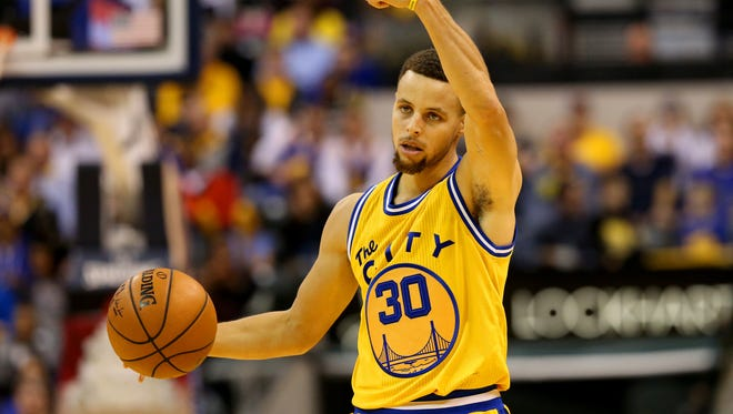 Golden State Warriors guard Stephen Curry (30) directs a teammate against the Indiana Pacers at Bankers Life Fieldhouse on Dec. 8, 2015.