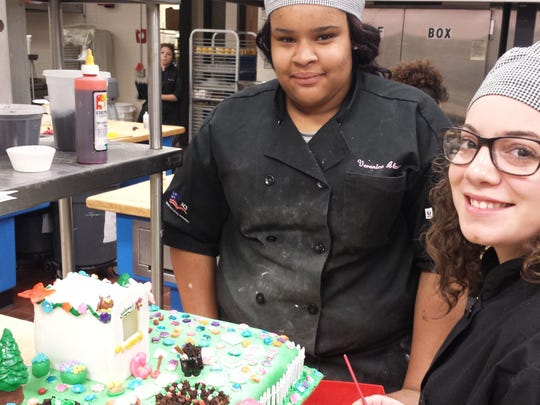 "Sophomores Janai Beck-Jones of Edison, left, and Jessica Jimenez of New Brunswick, created the winning entry in the ""Last Cake Standing"" competition conducted last month on the Piscataway campus of the Middlesex County Vocational and Technical Schools."