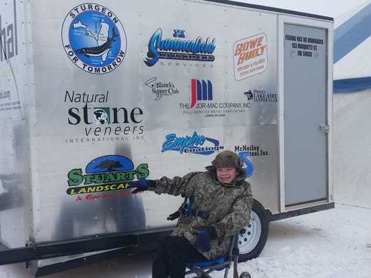 Kevin Kollmann, 14, who lives with a form of cerebral palsy, was part of the inaugural Fishing Has No Boundaries sturgeon spearing event last month on Lake Winnebago. Kevin helped his mom, Karen Kollmann, spear and pull out an 83.7 pound, 70.2 inch female sturgeon during the second weekend of spearing.