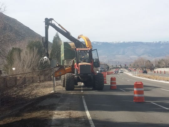 Trees and brush and grinded up along McCarran Boulevard ahead of construction