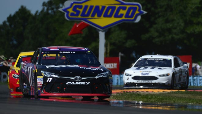 Denny Hamlin, driver of the No. 11 FedEx Freight Toyota, races during the NASCAR Sprint Cup Series Cheez-It 355 at The Glen on Sunday at Watkins Glen International.