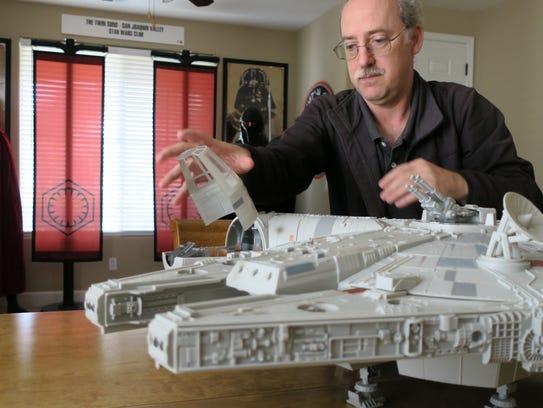 Star Wars enthusiast and collector Derek Mazer shows