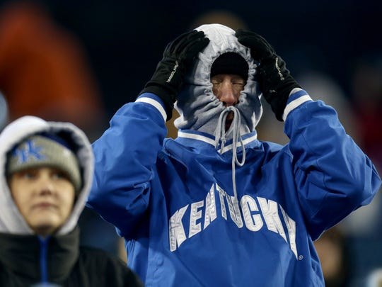 A bundled up Kentucky fan reacts to a player in the third quarter of the Music City Bowl at Nissan Stadium in Nashville, Tenn., Friday, Dec. 29, 2017.