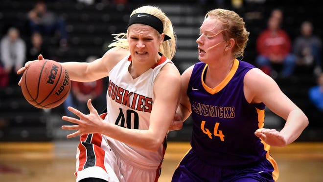 St. Cloud State's Kyli Van Klei drives to the basket against Minnesota-Mankato's  Claire Ziegler during Saturday's game at Halenbeck Hall in St. Cloud.