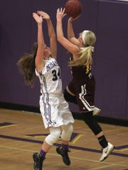 Indianola junior Haley Vesey defends against Ankeny junior Codee Myers. Class 5-A fifth-ranked Indianola beat Ankeny 52-47 in Indianola on Dec. 15.