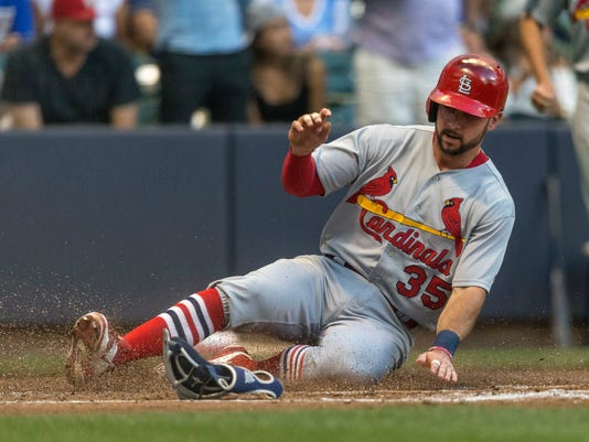 St. Louis Cardinals' Greg Garcia scores on a Matt Holiday single against the Milwaukee Brewers during the third inning of a baseball game Friday, July 8, 2016, in Milwaukee. (AP Photo/Tom Lynn)