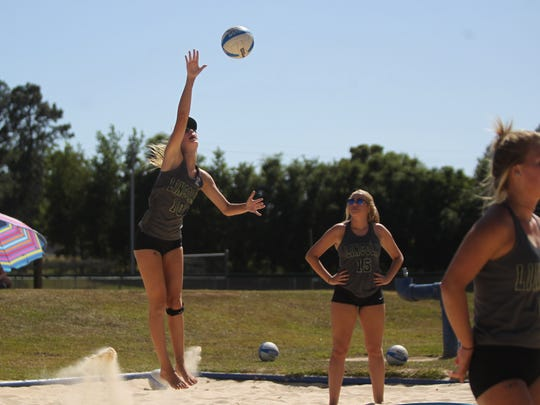 Lincoln's Lexi Fitzpatrick serves at the 2018 Tallahassee high school beach volleyball city tournament at Tom Brown Park