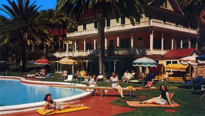 A postcard from the 1950s shows guests relaxing at Castle Hot Springs Resort.