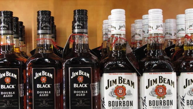 In this Monday, Jan. 13, 2014, photo, Jim Beam and Maker?s Mark bottles line the counter at the Jim Beam visitors? center at Clermont, Ky.