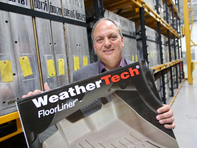 David MacNeil, founder and CEO of MacNeil Automotive Products, shows WeatherTech FloorLiners, which are produced at the company's headquarters and manufacturing facility in Bolingbrook, Ill.