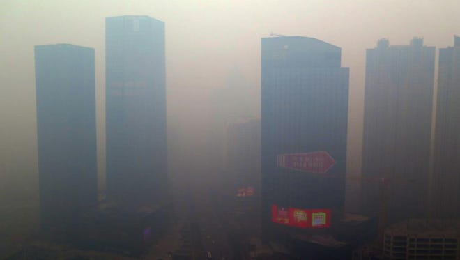 Residential buildings in Shenyang, in northeastern China, are shrouded in smog on Nov. 8.