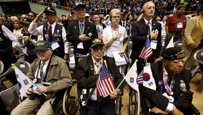 US and South Korean veterans of the Korean War salute during a ceremony of the 66th Anniversary of the Korean War on June 2016.
