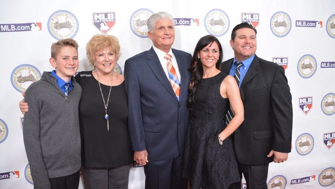 Scott Reid with his son, Brian (right), daughter-in-law J.J. (right), wife Sherry (left) and grandson Jackson (left) at Scouts Foundation dinner this off-season.