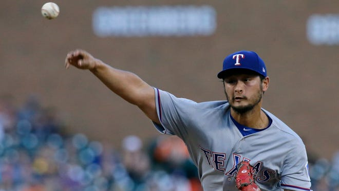 Yu Darvish pitches against the Detroit Tigers.